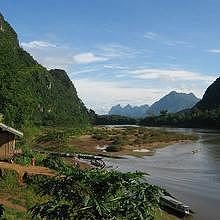 Muang Ngoi in a karst landscape covered by a deep jungle