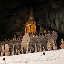 Pak Ou caves, Buddha statues in stone, in wood